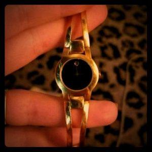 Woman's, gold Movado wrist watch
